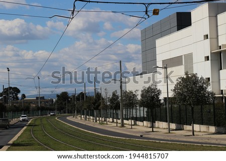 tram railway with sheds, grass and blue sky Foto stock ©