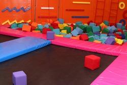 Trampoline, climbing wall at children's playroom, entertainment center