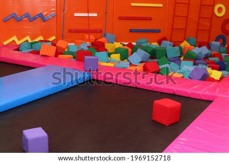 Trampoline, climbing wall at children's playroom, entertainment center Photo stock ©