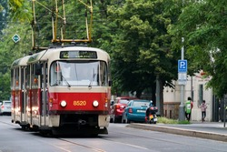 Tramway T3 in Prague street. Old Czech red tram number 12 in Prague. Vintage public transport in the capital of the Czech republic. Translation: