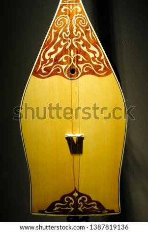 Tranditional Kazakh dombra (dombyra) musical string instrument #1387819136