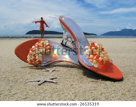 Trandy shoes on the sand of Langkawi island, Malaysia