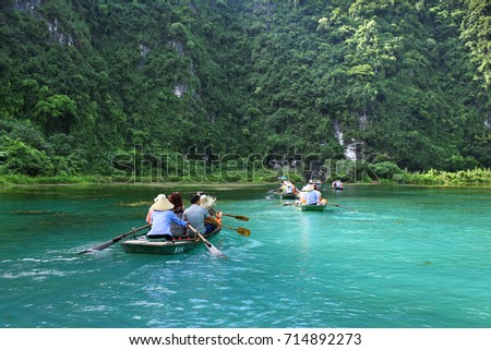 Trang An Scenic Landscape Complex (UNESCO World Heritage Site), Ninh Binh province, Vietnam - August 20, 2017: Travellers in Trang An boat cave tours
