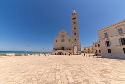 Trani, Puglia, Italy, June 2021: The Santa Maria Assunta Cathedral, also named San Nicola Pellegrino Cathedral located in duomo square of Trani. Minor basilica in Apulian Romanesque architecture