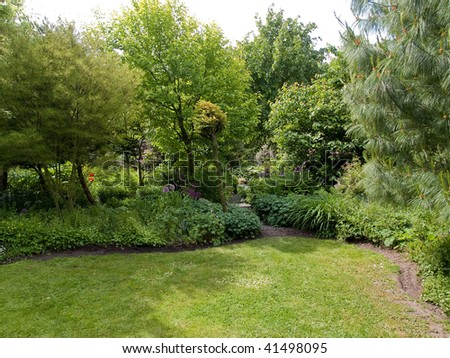Tranquil Beautiful Garden with Lush Green Trees and Grass