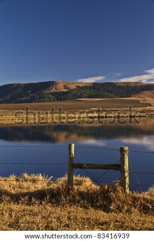 Tranquil dam in Natal Midlands South Africa during Winter