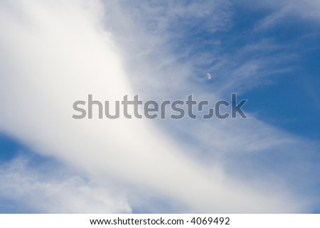 tranquil daytime cloudscape with moon - stock photo
