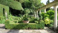Tranquil Formal Garden Scene with Verdant Topiary Parterre