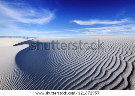 Tranquil image of sand dunes and beautiful blue sky, White Sands National Monument.