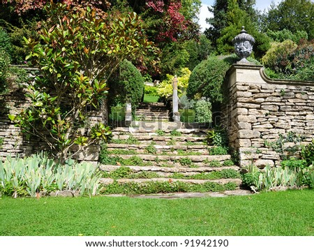 Tranquil Landscape Garden Scene of a Freshly Mown Lawn and Steps to an Upper Level