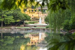 Tranquil pond with reflections at Fort Worth Botanical Garden