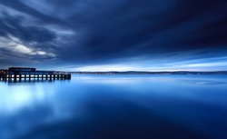 Tranquil sea at the mouth of weymouth harbour in dorset england