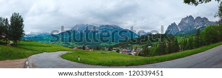 Tranquil summer Italian dolomites mountain view with village in valley