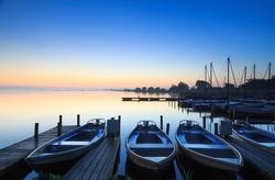 Tranquil sunrise at a small marina on a lake.