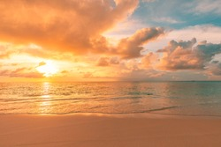 Tranquil sunset nature, sea sand sky clouds and horizon, panoramic banner view. Fantastic nature landscape, beautiful colors, wonderful scenery of tropical beach. Beach sunset, summer vacation