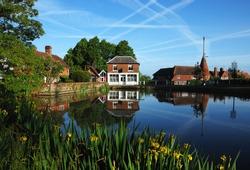 Tranquil village pond with oast houses, Goudhurst, Kent. UK