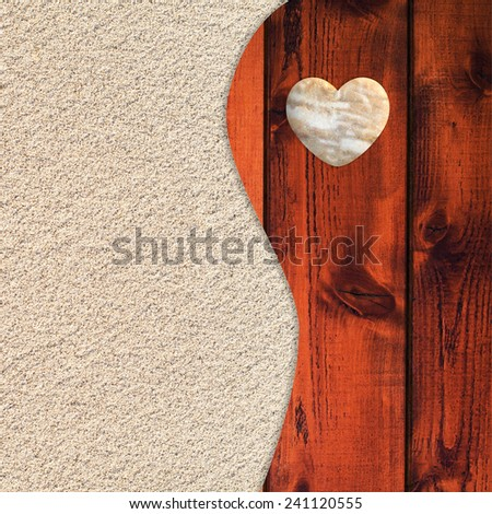 Tranquil zen-like pattern from two parts includes sand and planks background with heart shaped pebble.