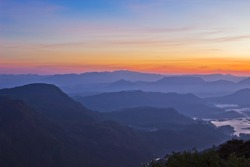 Tranquility colorful mountain landscape in fog at sunrise. View from Adam peak in Sri Lanka, Ceylon