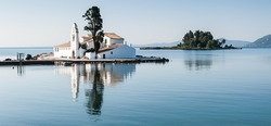 Tranquility. The church of Panagia Vlacherna and the island of Pontikonissi (mouse island) on a quiet tranquil morning.Taken in Corfu, Greece.