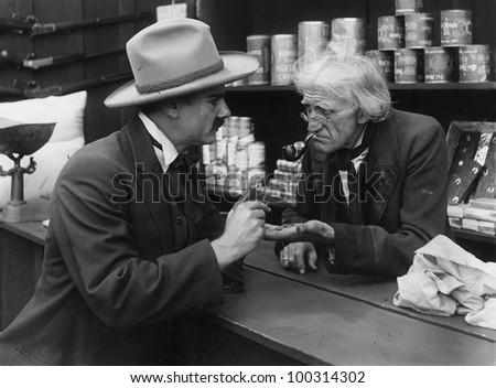 Transaction with elderly shopkeeper