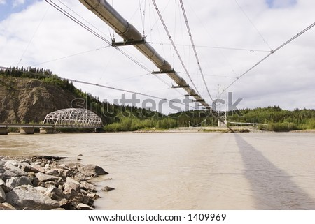 Transalaska oil pipeline and Richardson Hwy Bridges over Tanana river near Delta Junction, AK