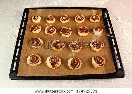 Transfering to baking tray lined with parchment paper. Making Poppy Seed Snail. Sweet Roll Bun.