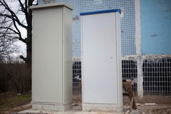 Transformer box with electrical equipment. Metal cabinet on the street for centralizing communications.