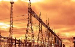 Transformer : The equipment used to raise or lower voltage, high voltage power station. High voltage electric tower on  sky  background.