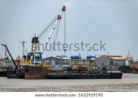 Transhipment of goods between ships on the Chao Phraya River, Samut Prakan Thailand.