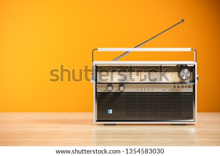 Transistor radio receiver on wood table in home interior. 3d render Stock photo ©
