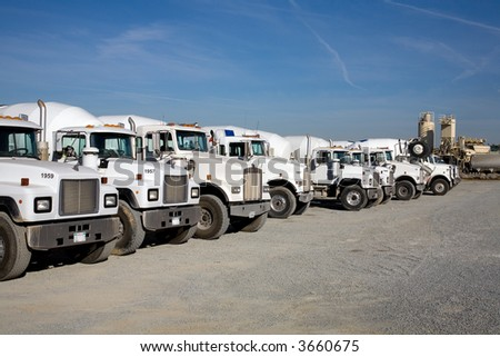 Transit mix concrete trucks ready to deliver their loads to construction job site