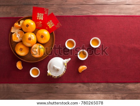 Translation of text appear in image: Prosperity and Spring. Flat lay Chinese new year food and drink still life. Text space image.