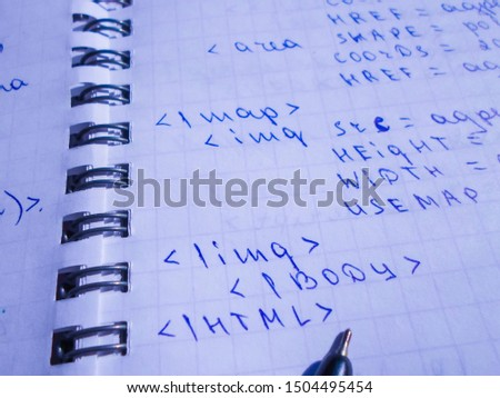 translations of calculus systems on a notebook and black pen. creation of computer programs. work of the programmer and system administrator
