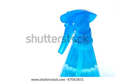 Translucent blue spray bottle against pure white background