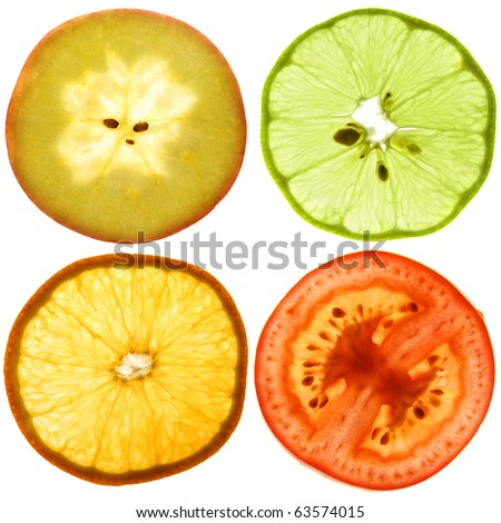 Translucent cut of a ripe apple, orange, tomato and green lemon. Isolated on white.