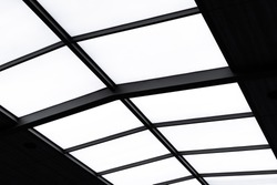 Translucent roof or skylight roof of shopping center. structural steel frame inside arched roof with sunlight. Translucent roof for save energy