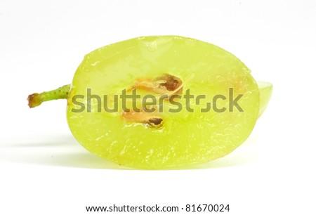 Translucent slice of green grape fruit, macro isolated on white
