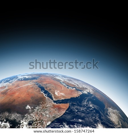 Transluner coast view of Earth over Africa Saudi Arabia Black background with Blue Halo Elements of this image furnished by NASA