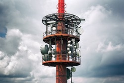 Transmission radio / tele tower - equipment for transmitting signal of mass communication mediums, radio and television. Stormy cloudy sky in the background