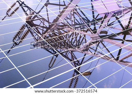 transmission tower reflected in the solar panel
