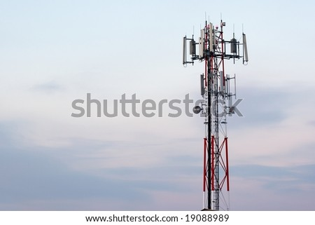 Transmitter tower against bright sky