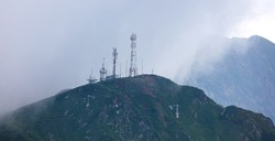 Transmitting antenna on a mountain in the fog.