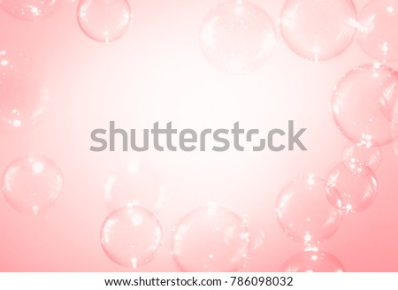 Transparency soap bubbles on pink background
