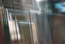 Transparent and polished glass panes in glass polishing factory.