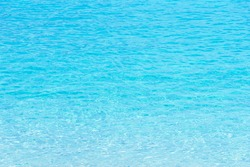 Transparent blue sea water background in Tropical summer beach, summer background.