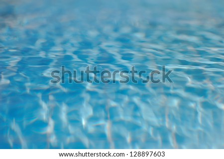 transparent blue water with soft waves in the pool
