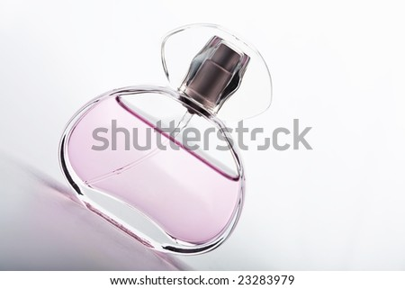 transparent bottle of pink perfume