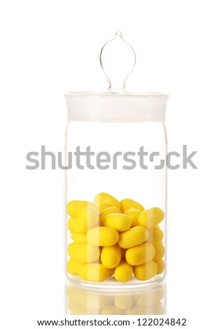 Transparent bottle with pills isolated on white