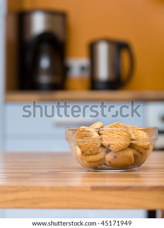 Kitchen Table Close Up transparent bowl with cookies close up shoot on the kitchen table