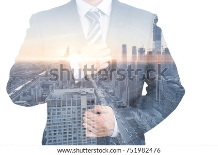 transparent businessman and city skyline with blank white background. #751982476